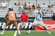 Joe Walters #1 of the Chesapeake Bayhawks takes a shot against the defense of John Locascio #4 of the Rochester Rattlers during the second quarter at Eunice Kennedy Shriver Stadium on July 12, 2015 in Brockport, New York.  The Rattlers defeated the Bayhawks 14-13.