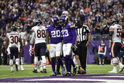 Mackensie Alexander #20 of the Minnesota Vikings celebrates with teammate Terence Newman #23 turning over the Chicago Bears in the fourth quarter of the game on December 31, 2017 at U.S. Bank Stadium in Minneapolis, Minnesota.