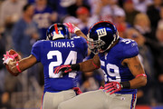 Terrell Thomas #24 of the New York Giants celebrates after an interception against the Chicago Bears with teammate Michael Boley #59 at New Meadowlands Stadium on October 3, 2010 in East Rutherford, New Jersey.