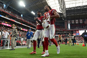 Defensive back Jamar Taylor #28 and wide receiver Larry Fitzgerald #11 of the Arizona Cardinals walk off the field after the NFL game against the Chicago Bears at State Farm Stadium on September 23, 2018 in Glendale, Arizona. The Chicago Bears won 16-14.