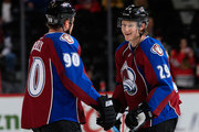 Ryan O'Reilly #90 and Nathan MacKinnon #29 of the Colorado Avalanche warm up priot to facing the Chicago Blackhawks at Pepsi Center on December 27, 2014 in Denver, Colorado.