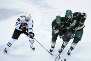 Kyle Brodziak #21 and Cody McCormick #8 of the Minnesota Wild controls the puck against Patrick Kane #88 of the Chicago Blackhawks during the first period in Game Three of the Second Round of the 2014 NHL Stanley Cup Playoffs on May 6, 2014 at Xcel Energy Center in St Paul, Minnesota.