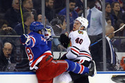 Marc Staal #18 of the New York Rangers is checked by John Hayden #40 of the Chicago Blackhawks during the first period at Madison Square Garden on January 3, 2018 in New York City.