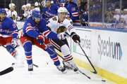 Rick Nash #61 of the New York Rangers and Connor Murphy #5 of the Chicago Blackhawks battle for the puck during the second period at Madison Square Garden on January 3, 2018 in New York City. The Blackhawks defeated the Rangers 5-2.