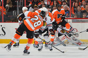 Wayne Simmonds #17 of the Philadelphia Flyers screens the shot by Claude Giroux #28 of the Philadelphia Flyers against the Chicago Blackhawks at the Wells Fargo Center on March 18, 2014 in Philadelphia, Pennsylvania.