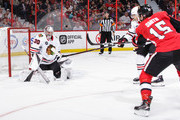 Cam Ward #30 of the Chicago Blackhawks makes a save against Zack Smith #15 of the Ottawa Senators at Canadian Tire Centre in the second period on October 4, 2018 in Ottawa, Ontario, Canada.