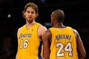 (L-R) Pau Gasol #16 and Kobe Bryant #24 of the Los Angeles Lakers talk on the court during the game against the Chicago Bulls on November 19, 2009 at Staples Center in Los Angeles, California.   NOTE TO USER: User expressly acknowledges and agrees that, by downloading and/or using this Photograph, User is consenting to the terms and conditions of the Getty Images License Agreement.