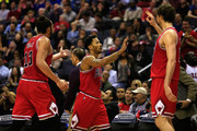 Derrick Rose #1 of the Chicago Bulls (C) celebrates after hitting a shot to end the first half with teammates Joakim Noah #13 and Pau Gasol #16 against the Washington Wizards at Verizon Center on December 23, 2014 in Washington, DC. NOTE TO USER: User expressly acknowledges and agrees that, by downloading and or using this photograph, User is consenting to the terms and conditions of the Getty Images License Agreement.