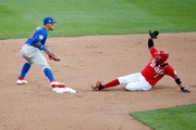 Javier Baez #9 of the Chicago Cubs forces out Nicholas Castellanos #2 of the Cincinnati Reds at second base during the seventh inning of the game at Great American Ball Park on August 29, 2020 in Cincinnati, Ohio. Chicago defeated Cincinnati 3-0.