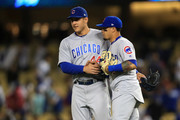 Anthony Rizzo #44 celebrates with Javier Baez #9 of the Chicago Cubs after defeating the Los Angeles Dodgers 9-4 in a game at Dodger Stadium on June 26, 2018 in Los Angeles, California.