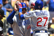 Addison Russell #27 of the Chicago Cubs hits a two run home run scoring Anthony Rizzo #44 in the seventh inning of the game against the Los Angeles Dodgers at Dodger Stadium on June 28, 2018 in Los Angeles, California.