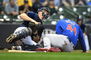 Anthony Rizzo #44 of the Chicago Cubs is tagged out at home plate by Erik Kratz #15 of the Milwaukee Brewers during the fifth inning at Miller Park on September 5, 2018 in Milwaukee, Wisconsin.