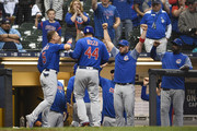 Anthony Rizzo #44 of the Chicago Cubs is congratulated by teammates following an 11th inning home run against the Milwaukee Brewers at Miller Park on June 11, 2018 in Milwaukee, Wisconsin.