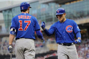 Kris Bryant #17 of the Chicago Cubs congratulates teammate Anthony Rizzo #44 on a solo home run against the Minnesota Twins during the fourth inning of the game on June 19, 2015 at Target Field in Minneapolis, Minnesota.