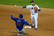 Asdrubal Cabrera #13 of the New York Mets completes a twelfth inning double play after forcing out Anthony Rizzo #44 of the Chicago Cubs at Citi Field on June 2, 2018 in the Flushing neighborhood of the Queens borough of New York City.