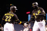 Gregory Polanco #25 of the Pittsburgh Pirates is congratulated by teammate Andrew McCutchen #22 after hitting a solo home run in the fifth inning against the Chicago Cubs during the game at PNC Park on April 22, 2015 in Pittsburgh, Pennsylvania.