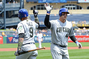 Anthony Rizzo #44 of the Chicago Cubs high fives with Javier Baez #9 after hitting a solo home run in the second inning during the game against the Pittsburgh Pirates at PNC Park on May 28, 2018 in Pittsburgh, Pennsylvania. MLB players across the league are wearing special uniforms to commemorate Memorial Day.