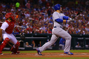 Anthony Rizzo #44 of the Chicago Cubs his a sacrifice fly against the St. Louis Cardinals RBI in the first inning at Busch Stadium on May 6, 2018 in St. Louis, Missouri.