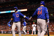 Javier Baez #9 of the Chicago Cubs is congratulated by Anthony Rizzo #44 after scoring during the ninth inning against the St. Louis Cardinals at Busch Stadium on May 4, 2018 in St Louis, Missouri.
