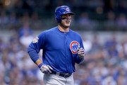 Anthony Rizzo #44 of the Chicago Cubs jogs to first base after being hit by a pitch in the first inning against the Milwaukee Brewers at Miller Park on September 4, 2018 in Milwaukee, Wisconsin.