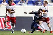 Dax McCarty #11 of the New York Red Bulls strips the ball from Patrick Nyarko #14 of the Chicago Fire in front of Roy Miller #7 of the New York Red Bulls during their match at Red Bull Arena on July 18, 2012 in Harrison, New Jersey.