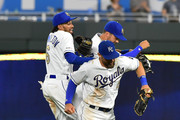 Billy Hamilton #6, Alex Gordon #4 and Whit Merrifield #15 of the Kansas City Royals celebrate a 6-4 win over the Chicago White Sox at Kauffman Stadium on June 7, 2019 in Kansas City, Missouri.