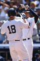 Johnny Damon #18 of the New York Yankees is congratulated by teammate Derek Jeter #2 after hitting a two run homer in the third inning against the Chicago White Sox during their game on August 30, 2009 at Yankee Stadium in the Bronx borough of New York City.