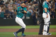 Ichiro Suzuki #51 of the Seattle Mariners laughs after imitating a pitcher's stance on the mound as the team celebrates their win at Safeco Field on July 20, 2018 in Seattle, Washington. The Seattle Mariners beat the Chicago White Sox 3-1.