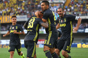 Federico Bernardeschi #33 of Juventus celebrates his goal with his team-mates Emre Can (C) and Giorgio Chiellini (R) during the serie A match between Chievo Verona and Juventus at Stadio Marc'Antonio Bentegodi on August 18, 2018 in Verona, Italy.