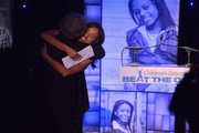 Event Co-Chair Jurnee Smollett (R) and Children's Defense Fund President Marian Wright Edelman onstage at the 23rd Annual Beat The Odds Awards hosted by Children's Defense Fund-California on December 5, 2013 in Beverly Hills, California.