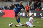 Tobin Heath of the United States tries to dribble around Carla Guerrero of Chili during their match at Avaya Stadium on September 4, 2018 in San Jose, California.