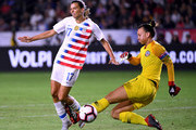 Tobin Heath #17 of United States blocks the kick of Christiane Endler #1 of Chile during the first half at StubHub Center on August 31, 2018 in Carson, California.
