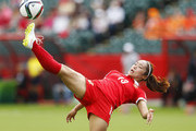 Tang Jiali #13 of China kicks the ball during the FIFA Women's World Cup Canada Group A match between China and Netherlands at Commonwealth Stadium on June 11, 2015 in Edmonton, Alberta, Canada.