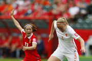 Stefanie Van Der Gragt #3 of Netherlands keeps the ball away from Tang Jiali #13 of China during the FIFA Women's World Cup Canada Group A match between China and Netherlands at Commonwealth Stadium on June 11, 2015 in Edmonton, Alberta, Canada.