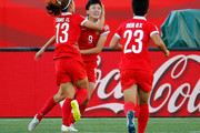Wang Shanshan #9 of China PR celebrates scoring their second goal against New Zealand with Tang Jiali #13 and Ren Guixin #23 during the FIFA Women's World Cup Canada 2015 Group A match between China PR and New Zealand at Winnipeg Stadium on June 15, 2015 in Winnipeg, Canada.