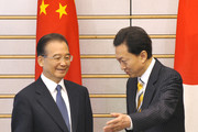 Japanese Prime Minister Yukio Hatoyama (R) welcomes visiting Chinese Premier Wen Jiabao prior to their talks at the latter's official residence on May 31, 2010 in Tokyo, Japan. Wen is on a three-day visit to Japan.
