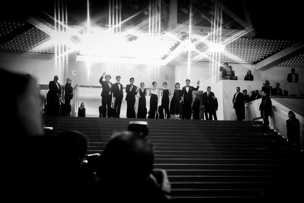 'Parasite' Red Carpet - The 72nd Annual Cannes Film Festival [image,white,black,photograph,black-and-white,monochrome,light,monochrome photography,snapshot,standing,crowd,starburst filter,bong joon-ho,cho yeo-jeong,lee sun-kyun,choi woo-shik,parasite red carpet,l-r,the 72nd annual cannes film festival,screening]