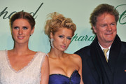 Nicky Hilton, Paris Hilton and Rick Hilton attend the Chopard 150th Anniversary Party at Palm Beach, Pointe Croisette during the 63rd Annual Cannes Film Festival on May 17, 2010 in Cannes, France.