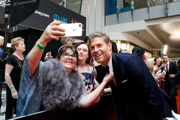 Celebrities Attend the 2019 AACTA Awards at The Star [people,crowd,event,technology,photography,electronic device,fan,premiere,games,performance,celebrities,chris brown,aacta awards,sydney,australia,the star,foxtel]