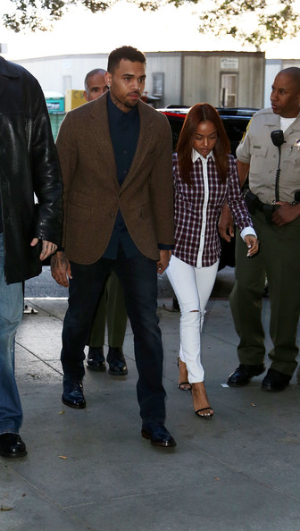 Chris Brown Recording artist Chris Brown enters the Los Angeles Courthouse on February 3, 2014 in Los Angeles, California.  Brown has been on probation since pleading guilty to assaulting his then girlfriend, singer Rihanna, after a pre-Grammy Awards party in 2009. He has been in anger management treatment program and performing community service requirements but failure to meet probation requirements could be even further complicated by assault charges he and bodyguard Christopher Hollosy face stemming from an incident outside the W hotel in Washington D.C. last October.