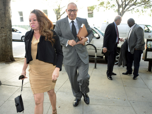 Joyce Hawkins (L) mother of R&B singer Chris Brown and attorney Mark Geragos (C) arrive for a probation violation hearing at Los Angeles Superior Court on March 17, 2014 in Los Angeles, California. Brown was arrested March 14 and is being held without bail.  The singer was first placed on probation after the 2009 domestic violence case in which he pleaded guilty to assaulting his then-girlfriend, singer Rihanna.