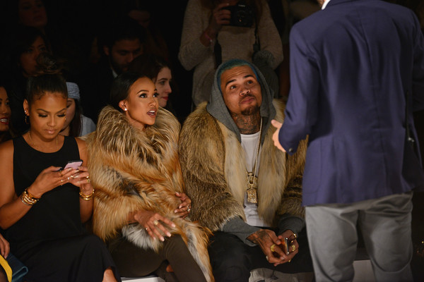 Michael Costello - Front Row - Mercedes-Benz Fashion Week Fall 2015 [people,fur,youth,event,fashion,human,adaptation,performance,crowd,night,michael costello,chris brown,christina milian,karrueche tran,front row,l-r,lincoln center,new york city,mercedes-benz fashion week,fashion show]