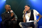 Radio personality Big Boy (L) and recording artist Chris Brown speak onstage during iHeartRadio Live with special guest T.I. at the iHeartRadio Theater Los Angeles on June 19, 2015 in Burbank, California.