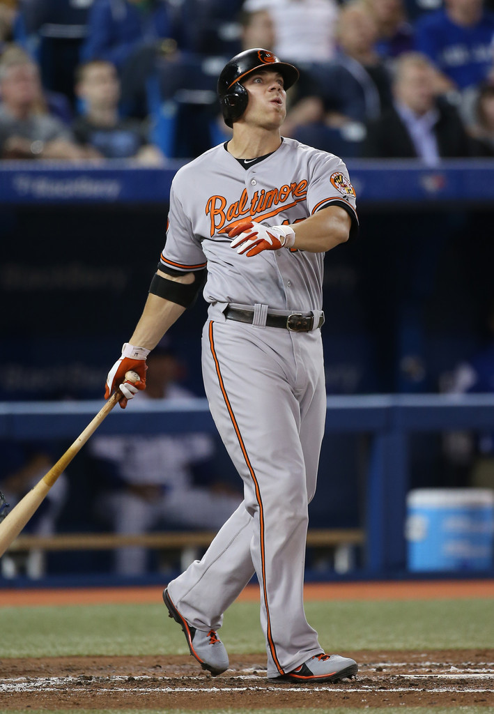 Chris Davis #19 of the Baltimore Orioles hits a solo home run in the fourth inning during MLB game action against the Toronto Blue Jays on May 23, 2013 at Rogers Centre in Toronto, Ontario, Canada.