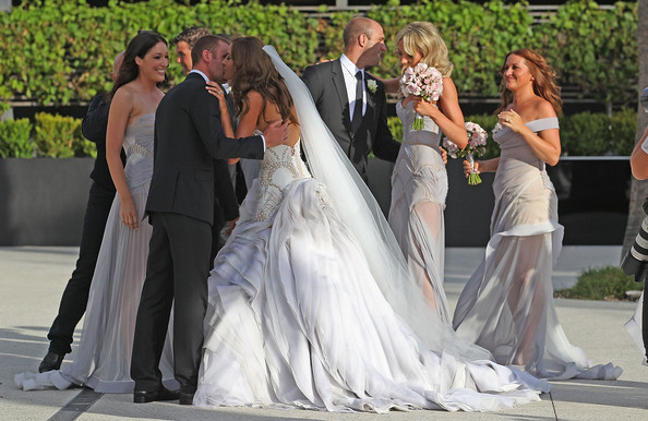 Bride Rebecca Twigley and groom Chris Judd greet guests after the wedding of AFL player Chris Judd and model Rebecca Twigley at Albert Park on December 31, 2010 in Melbourne, Australia.