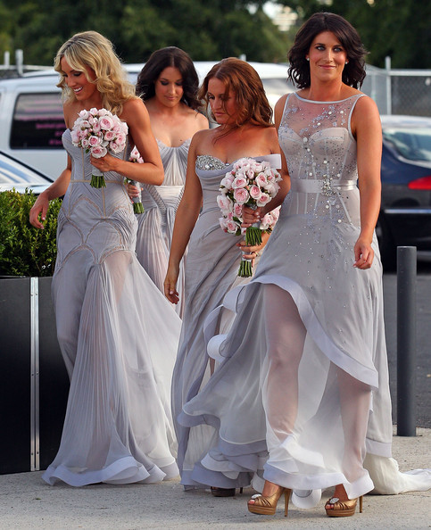 Bridesmaids arrive to attend the wedding of AFL player Chris Judd and model Rebecca Twigley at Albert Park on December 31, 2010 in Melbourne, Australia.