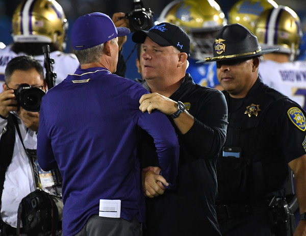 Washington vs. UCLA [police officer,police,official,security,event,law enforcement,military officer,uniform,gesture,military,chip kelly,chris petersen,police officer,security,washington,ucla,university of california,ucla bruins,washington huskies,rose bowl]