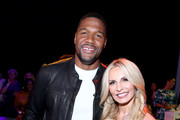 (L-R) Michael Strahan and Nicole Mather attend the front row for Christian Cowan during New York Fashion Week: The Shows at Gallery II at Spring Studios on September 10, 2019 in New York City.