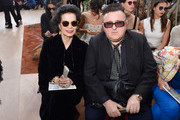 Bianca Jagger and Alber Elbaz attend the Christian Dior Haute Couture Fall/Winter 2017-2018 show as part of Haute Couture Paris Fashion Week on July 3, 2017 in Paris, France.