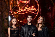 Ashley Weston, Darren Criss and Mia Swier attend the Loubicircus Party by Christian Louboutin at Musee des Arts Forains as part of Paris Fashion Week on June 19, 2019 in Paris, France.